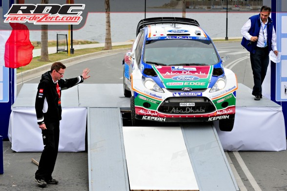 WRC driver Mikko Hirvonen (FIN) and co driver Jarmo Lehtinen (FIN) drive off and then break the podium ramp