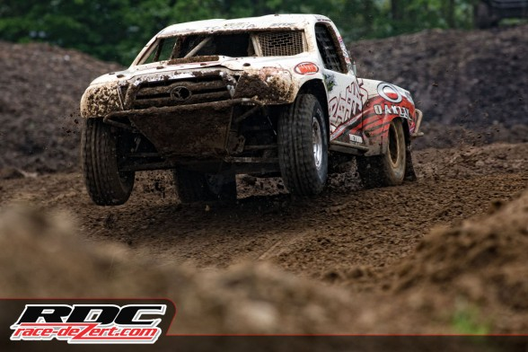 CJ Greaves charging through the mud