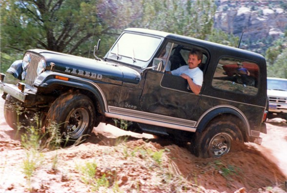 Charlie Currie beating the path in his Jeep