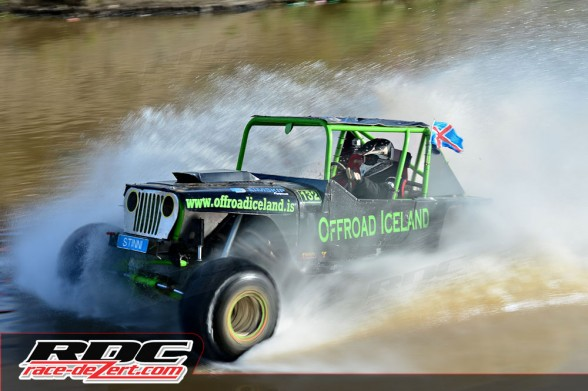 Unlimited driver Hafsteinn Porvaldsson (ISL) races across the top of a pond during course 6 of round 6