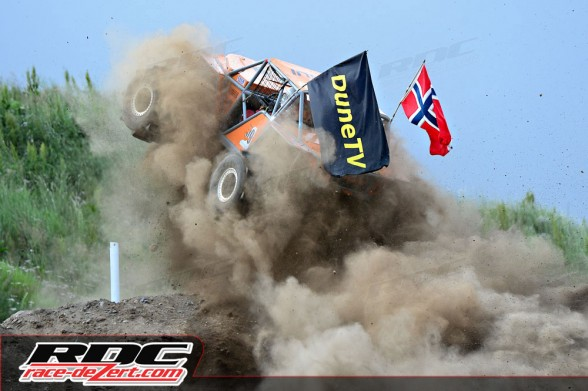 Unlimited driver Martin Michaelsen (NOR) jumps off the lip of a hill during course 3 of round 5