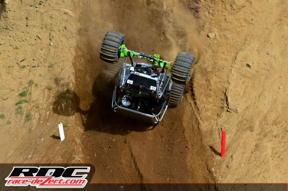 Modified driver Olafur Bjornsson flips over backwards and crashes during course 1 of round 6