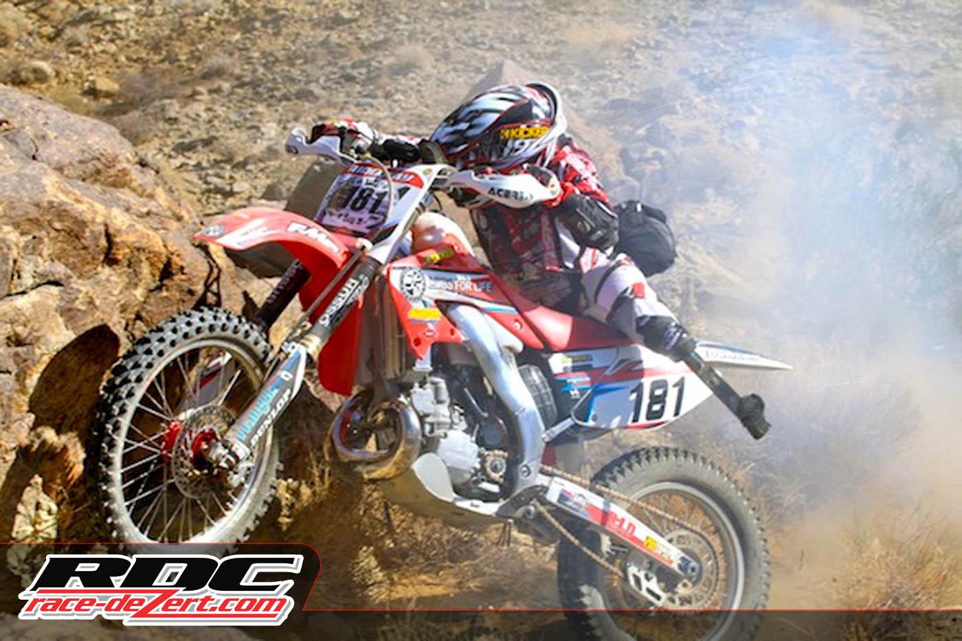 Amputee racer Chris Ridgeway hucks his HONDA up the rocky hill climb