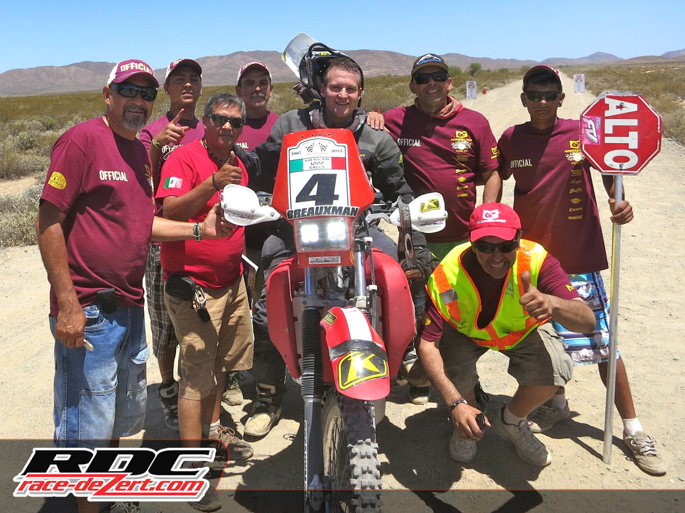 "#4 Celebrates with the ""Mexicali Boys"" at the end of stage 3 at Chapala Dry Lake"