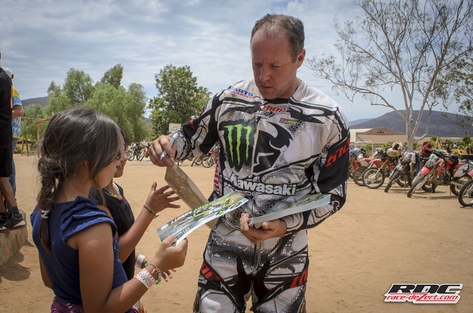 The consummate professional Destry Abbott hands out freshly autographed posters for some of the girls at Rancho Santa Marta Orphanage