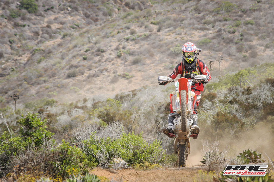 """Squirrel candidate Robert """"No Reason Passer"""" wheelies out of the canyon at the end of the Kayak Trail"""