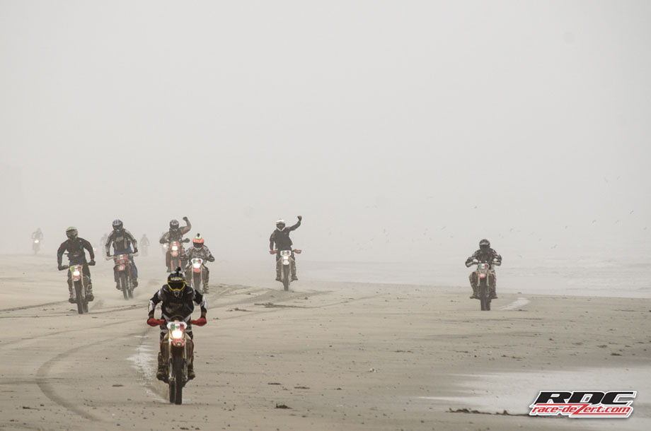 Johnny C leads 60 riders out of the mist en route to the Circle Races at San Antonio Del Mar