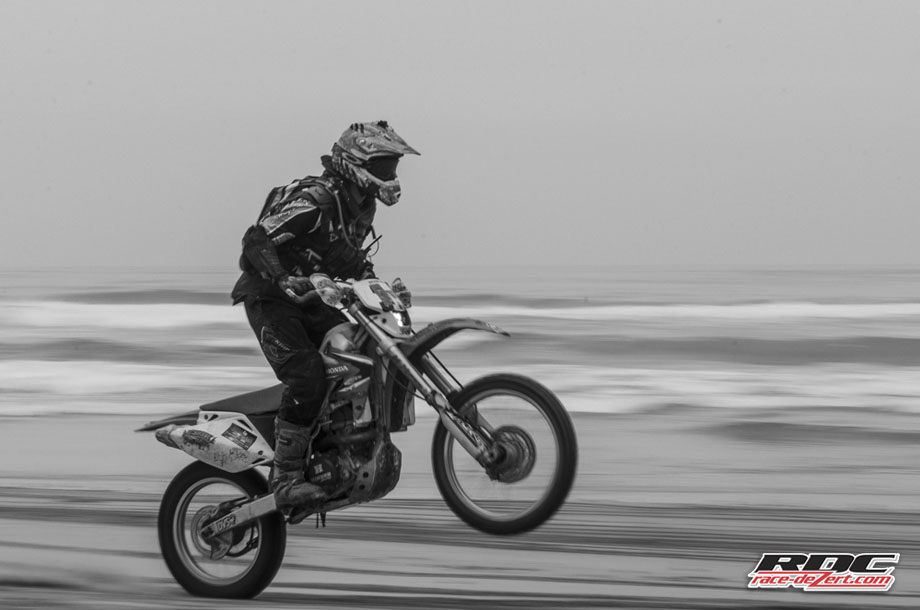 Unidentified Speed racer stands a power wheelie en route to the circle races at San Antonio Del Mar