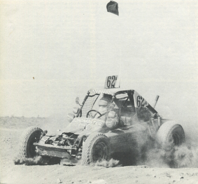 NEITHER DUST, ROCKS OR ACCIDENTS will stop Bobby Ferro from getting to finish line if possible. Ferro, behind wheel of Sandmaster-sponsored buggy, is shown after colliding with another vehicle during final lap of 1976 Mint 400, which he and co-driver Gene Hirst won.