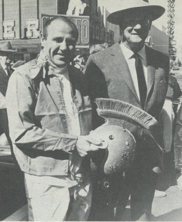 TROJAN WAR DRIVER—Earl Thompson (left), former Vice-President Sahara, Nevada Corporation, talked race business with boss Del Webb prior to 1969 Mint 400. (L.V.N.B.)