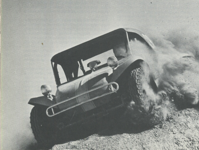 EARLY MINT—A fiberglass race car plows through silt at Tule Springs in 1969 Mint 400. (L.V.N.B.)