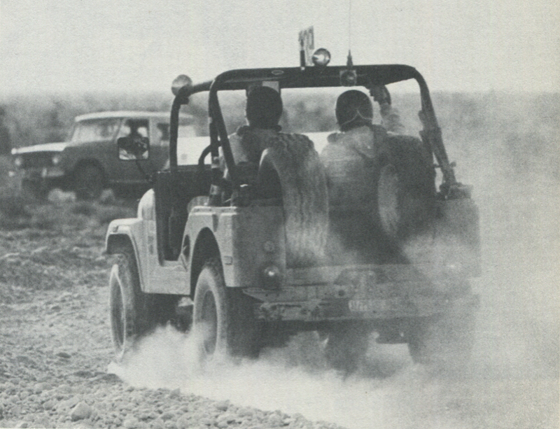 DUSTY ROADS IN NEVADA—Lonely is the man who competes in off-road racing, unless he is in two-seat class or behind wheel of Jeep as shown here. (L.V.N.B.)
