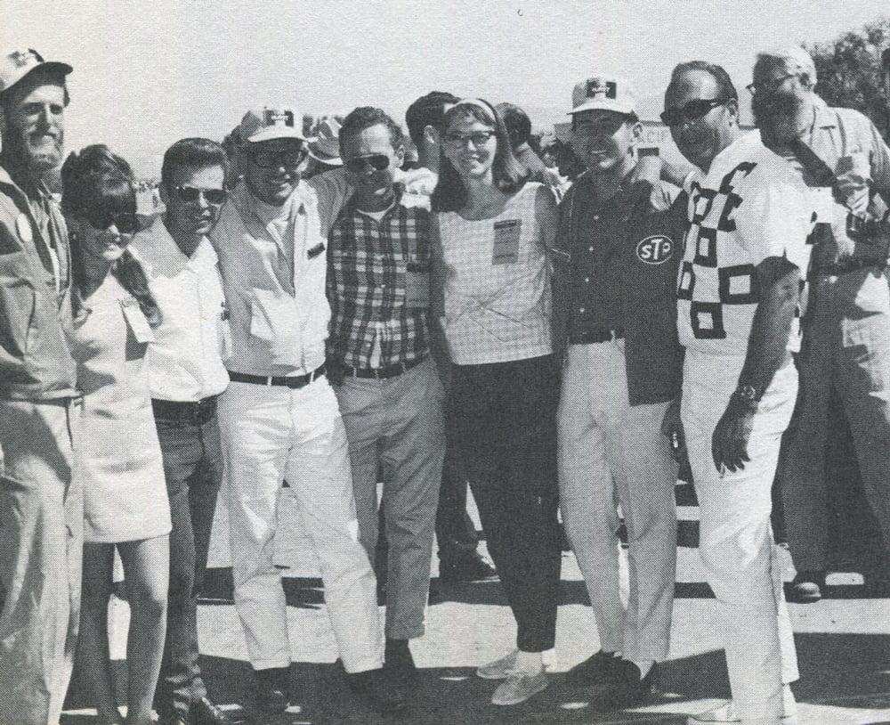 "'67 BAJA 1000 at the finish in La Paz. Some of the ""wizards"" (l to r): Lou Gross, Assist. Steward; Jeanne Allen, NORRA Secretary; Roger Musser, race Chairman; Ed Pearlman, the boss; John Christy, advisor; Charlene Megowan, NORRA staff; Norm Jacobson, Chief Scorer; Dick Kieth, Starter; Elmer ""Ernie"" Waring, Chief Tech Insp."