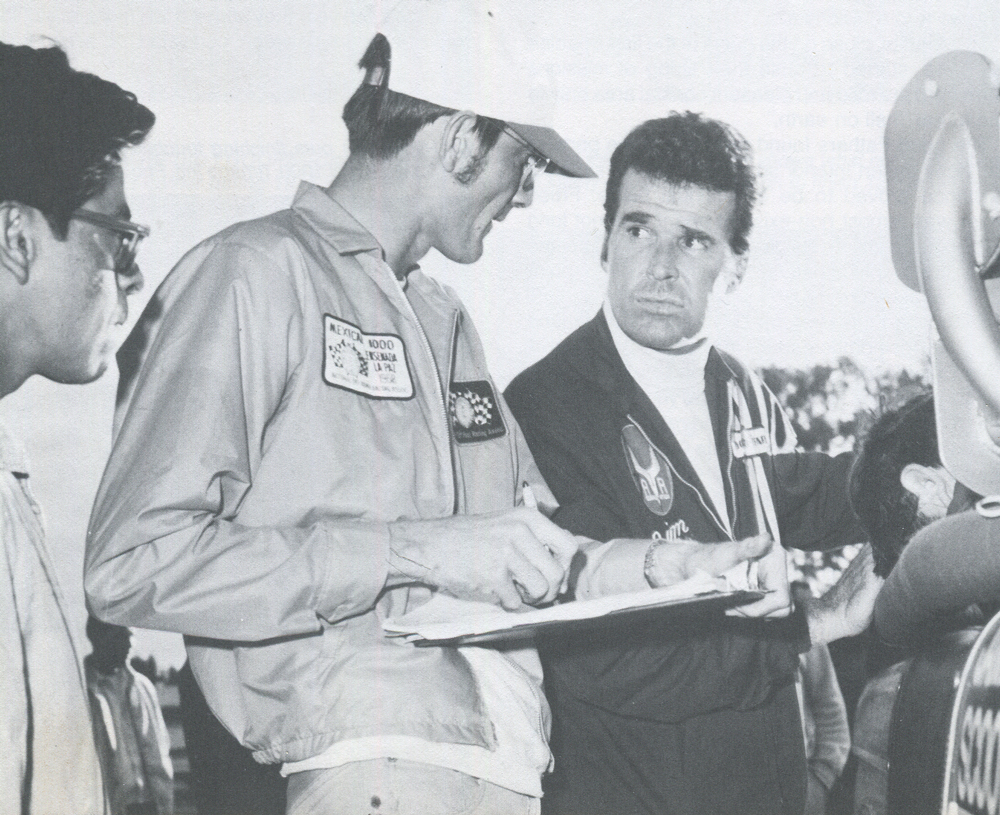 """'68 MEXICAN 1000—Jim Garner and John Hawley (l.) talk over a technical problem, or, """"Sorry, John, we just haven't got a part for you in the new picture!"""""""