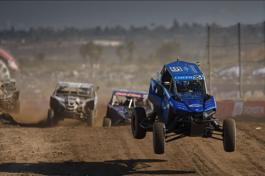 (Left to right) Corry Weller opened up her Turbo UTV title defense with a Saturday win, while Myles Cheek earned his first career Production 1000 UTV victory. Photo: Lucas Oil Off Road Racing Series