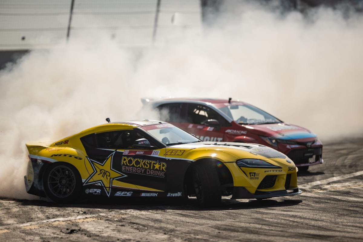 Papadakis Racing drivers Fredric Aasbo (2020 Rockstar Energy Drink Toyota GR Supra) and Ryan Tuerck (the Gumout / Nitto Tire / Toyota Corolla) tandem drift at an Irwindale Speedway team test earlier this year. (Larry Chen Photo)